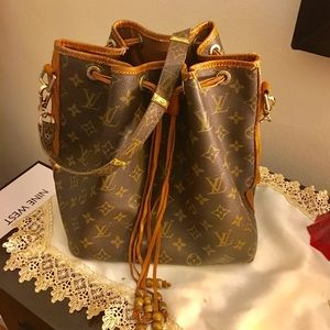 Louis Vuitton authentic bucket bag open to offers